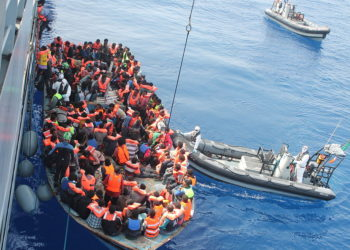 CC BY 2.0 Irish Defence Forces - Irish Naval personnel from the LÉ Eithne (P31) rescuing migrants as part of Operation Triton.